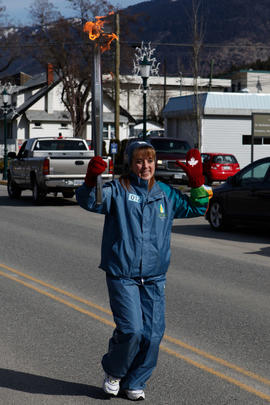 Torchbearer 12 Cathy Allen carries the flame in Lytton, BC