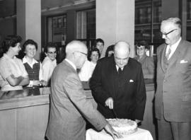 [Major J.S. Matthews cuts a cake to celebrate the 50th Anniversary of the Imperial Bank of Canada...