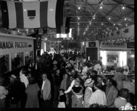Crowd and exhibits in Pure Foods building