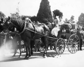 [Mrs. Gertrude Redford, W.J. McGuigan and others in a carriage during the rededication of Stanley...