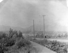 [Looking north near Centre (Granville) Street from Ninth Avenue (Broadway)]