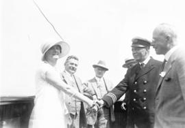 [Unidentified woman shakes hands with ship's captain at City Hall employee picnic]