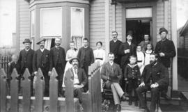 [W.H. Gallagher and others on a verandah]
