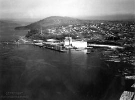 Aerial view of Alberta Wheat Pool elevator under construction and the East Vancouver Port Lands
