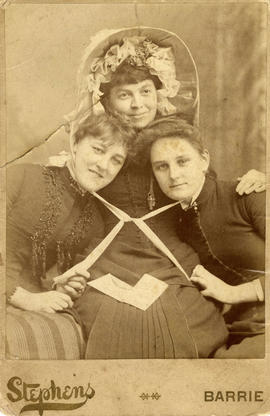 Harriet Ellen Lee (centre) in 100 year old bonnet - with two friends
