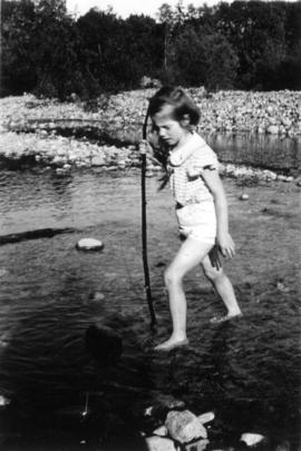 Jane Banfield wading at the beach