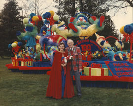 Miss P.N.E. and unidentified man in front of P.N.E. Centennial float