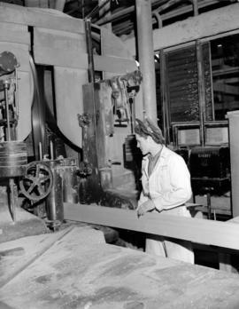 Alaska Pine [showing] girl operating lathe
