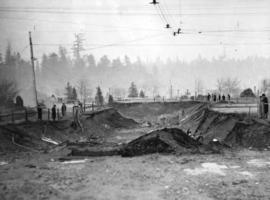 [An excavation for a pedestrian subway near the entrance to the park during the causeway and brid...