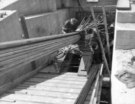 Clamping the last of the 61 wire ropes which go into each cable.  One of the cable anchorages on ...