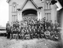 [Men and women assembled outside First Baptist Church, at the southwest corner of Dunsmuir and Ha...
