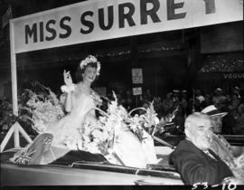 Miss Surrey waving from car in 1953 P.N.E. Opening Day Parade