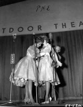 Anna Finlayson, winner of Miss P.N.E. 1959, on Outdoor Theatre stage with P.N.E. director M.L. Ba...