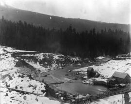 Coquitlam Dam [showing] view downstream from east bank over spillway