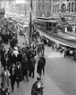 [Crowds gathered at Granville and Pender Streets for celebration]