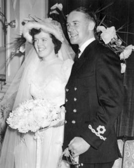 [Sub-Lieutenant Glen McDonald, R.C.N.R. and Miss Sidney Elizabeth Woodward on their wedding day]