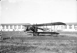 """J.C. [James Crookall] and plane"""