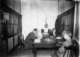 Three men in a Canadian Pacific Railways office