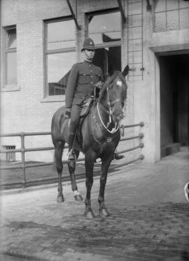 Member of Vancouver Police mounted on a horse