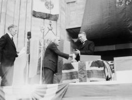 Fred L. Townley, architect, presents the mayor with gilded trowel [at City Hall]