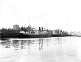 "[Three steam ships at dock including ""Governor""]"