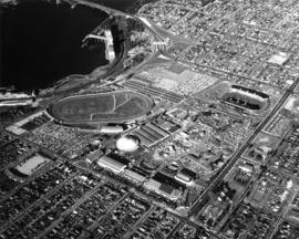 Aerial view of P.N.E. grounds and surrounding area looking northeast