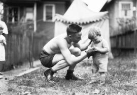 [Boxer McLarousse with small child]