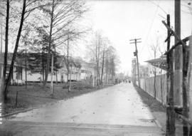 [View of road in Hastings Park, showing buildings, and soldiers stationed in nearby barracks]