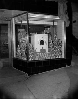[Spork's canned meat and Bendix washing machine display in a store window]
