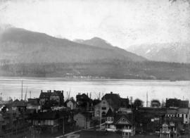 [View from Dunsmuir Street and Granville Street showing the] business district in early days