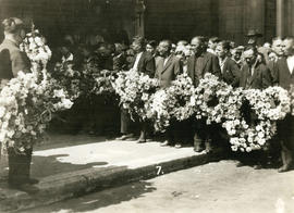 [Men holding wreaths for Yip Sang funeral procession]