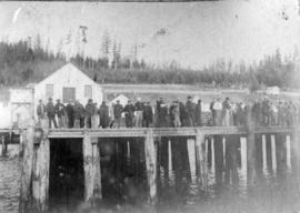 [People standing on a pier in Alert Bay]