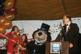 Man in costume, Megan Metcalfe, Tillicum and Mike Harcourt on stage at Vancouver's 99th birthday ...