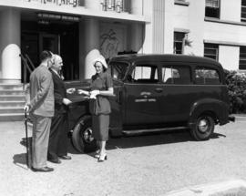 Mrs. Maitland McCarthy receiving keys from W. O. Banfield at Shaugnessy Hospital, accompanied by ...
