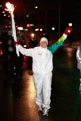 Day 60 Torchbearer 4 Mary Beth Reynolds carries the flame in Kitchener, Ontario.