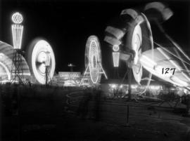 Illuminated amusement rides in P.N.E. Gayway at night