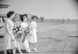 [Women carrying bouquets of flowers at the launch of first bomber from the Boeing plant on Sea Is...