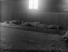 [Totem pole lying in house on Musqueam Reserve]