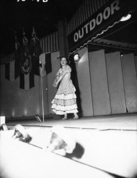 Girl singing on P.N.E. Outdoor Theatre stage