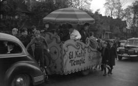 [Children gathered around the float and members of the Shriner El-Kahf Temple of Spokane, Washing...