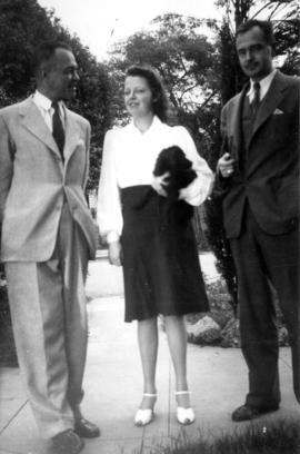 Ted, Mary, Ken Taylor [standing outside]