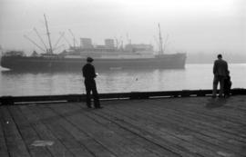 [View of freighter from dock]