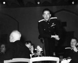 Barossa Day dinner, member of the regiment standing on chair to make a speech