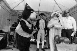 Tillicum and actors wearing costumes on stage