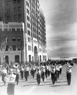 [A military band in the Diamond Jubilee Parade marching past the Marine Building at the foot of B...