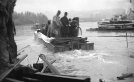 [Amphibious army truck being launched on the Fraser River]