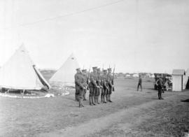 [Group of soldiers on drill in front of tents]