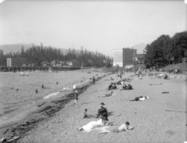 [English Bay beach, showing bathers and surrounding buildings]