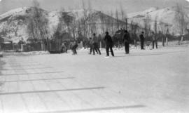 [Playing hockey in an internment camp]