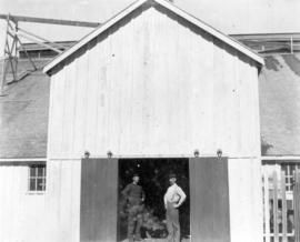 [Unidentified men and building at Rivers Inlet]